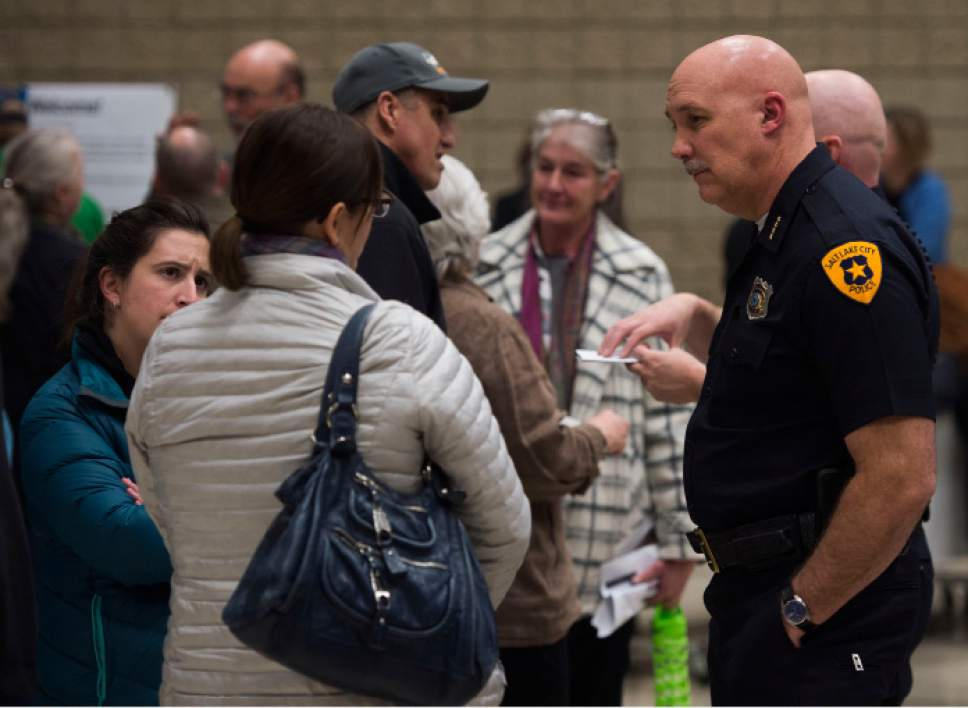 Steve Griffin / The Salt Lake Tribune  Salt Lake City Police Chief Mike Brown talks with residents during their final chance to influence the design and imprint of four 150-bed homeless shelters through community workshops organized by city administrators. The city has invited suggestions in advance of hiring an architect and entering zoning and conditional use processes that may take up to a year and a half at some sites, including the controversy-ridden 653 E. Simpson Ave. location. The event was held at the Nibley Park Elementary School Auditorium in Salt Lake City Wednesday January 18, 2017.