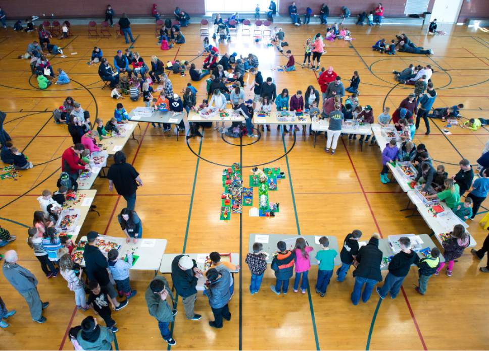 Leah Hogsten  |  The Salt Lake Tribune Over 800 kids sorted through 50,000 pieces of LEGOs to make additions to the Salt Lake Valley out of LEGO in the hopes of getting kids interested in engineering and other STEM and STEAM-related fields at the Gene Fullmer Recreation Center, February 25, 2017.