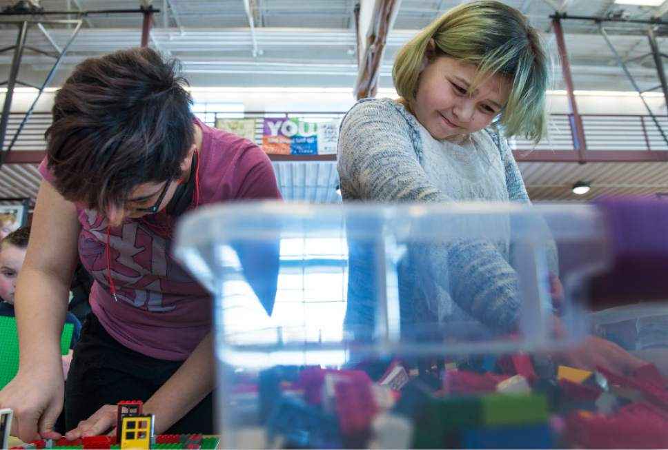 Leah Hogsten  |  The Salt Lake Tribune l-r Amber Kingdon, 14, and her sister Mia, 12, don't own LEGOs so they had fun constructing a school and a replica of their house to add to the city.  Over 800 kids sorted through 50,000 pieces of LEGOs to make additions to the Salt Lake Valley out of LEGO in the hopes of getting kids interested in engineering and other STEM and STEAM-related fields at the Gene Fullmer Recreation Center, February 25, 2017.
