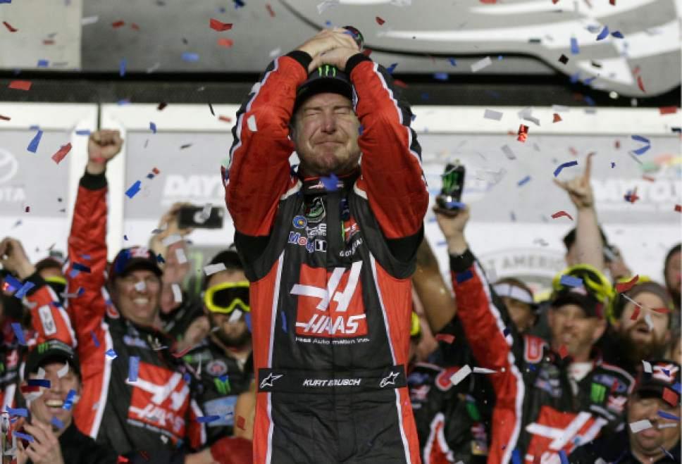 Kurt Busch celebrates in Victory Lane after winning the NASCAR Daytona 500 auto race at Daytona International Speedway in Daytona Beach, Fla., Sunday, Feb. 26, 2017. (AP Photo/Chuck Burton)