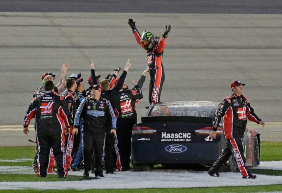Kurt Busch, top, celebrates with crew members after winning the NASCAR Daytona 500 auto race at Daytona International Speedway in Daytona Beach, Fla., Sunday, Feb. 26, 2017. (AP Photo/Terry Renna)