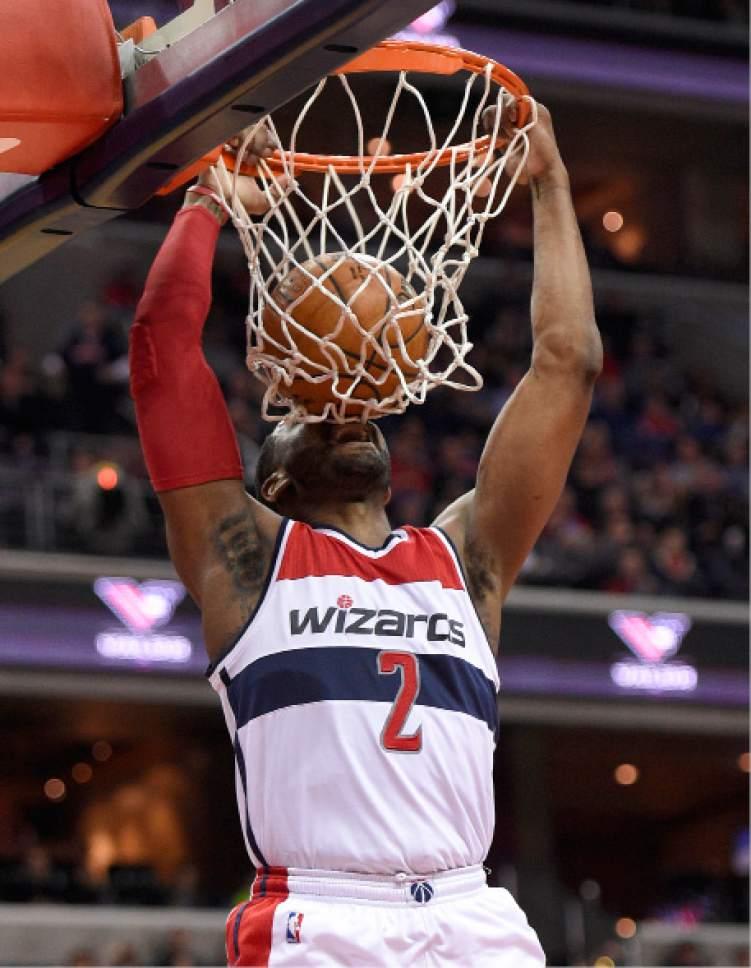 Washington Wizards guard John Wall (2) dunks during the first half of an NBA basketball game against the Utah Jazz, Sunday, Feb. 26, 2017, in Washington. (AP Photo/Nick Wass)