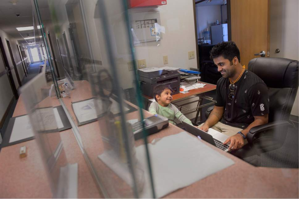 "Leah Hogsten  |  The Salt Lake Tribune Kunal shares a laugh with his son, Keshav, 3, while working in the hotel office. ""This reunion I visualized in my head for years and years and years,"" said Kunal Sah. ""It happened yesterday and I'm trying to soak it in."" Kunal's parents, Ken and Sarita, were forced to leave the country in 2006 after losing their legal battle with U.S. Immigration authorities. Kunal has been running the family's hotel business in Green River since 2011, trying to keep his parentsí dream alive without them."