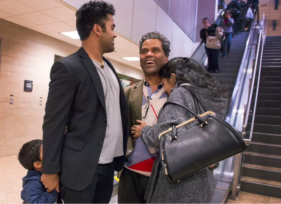 Leah Hogsten  |  The Salt Lake Tribune Kunal Sah, 23, welcomes his father, Ken Sah, back to the U.S. for the first time in over 10 years at the Salt Lake International Airport. Sarita Sah arrived in Utah three weeks ago, ahead of her husband. Kunal's parents, Ken and Sarita, were forced to leave the country in 2006 after losing their legal battle with U.S. Immigration authorities. Kunal has been running the family's hotel business in Green River since 2011, trying to keep his parents' dream alive without them.