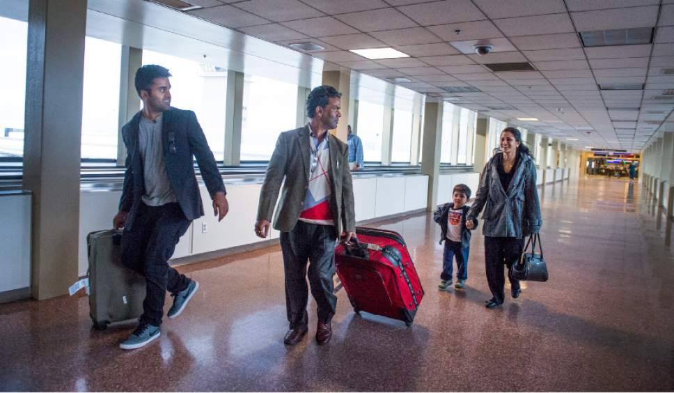Leah Hogsten  |  The Salt Lake Tribune l-r Kunal Sah, 23, father, Ken, mother Sarita and son Keshav, 3, leave the Salt Lake International Airport to drive home to Green River, Utah. The Sahs are all together in the U.S. for the first time in over 10 years. Sarita Sah arrived in Utah three weeks ago, ahead of her husband. Ken and Sarita, were forced to leave the country in 2006 after losing their legal battle with U.S. Immigration authorities. Kunal has been running the family's hotel business in Green River since 2011, trying to keep his parentsí dream alive without them.