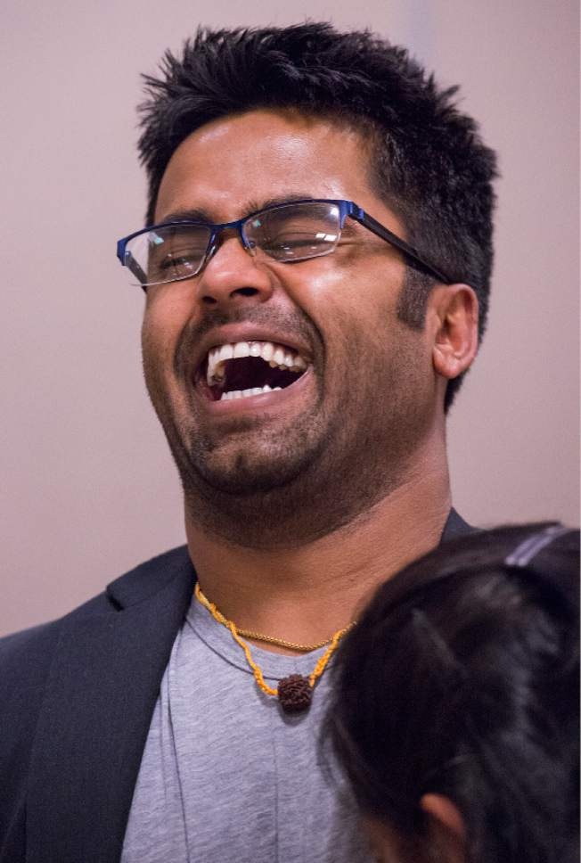 "Leah Hogsten  |  The Salt Lake Tribune ""More than half my life's been consumed with this immigration case so it's just a huge weight off my shoulders,"" said Kunal Sah. Kunal Sah, 23, is jubilant as he anticipates the arrival of his father, Ken Sah, back to the U.S. for the first time in over 10 years. Kunal's parents, Ken and Sarita, were forced to leave the country in 2006 after losing their legal battle with U.S. Immigration authorities. Kunal has been running the family's hotel business in Green River since 2011, trying to keep his parentsí dream alive without them."