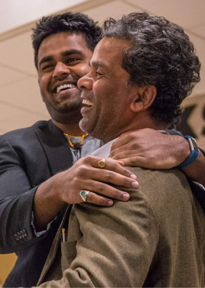 Leah Hogsten  |  The Salt Lake Tribune  Kunal Sah, 23, welcomes his father, Ken Sah, back to the U.S. for the first time in over 10 years at the Salt Lake International Airport. Ken and Sarita, were forced to leave the country in 2006 after losing their legal battle with U.S. Immigration authorities. Kunal has been running the family's hotel business in Green River since 2011, trying to keep his parents' dream alive without them.