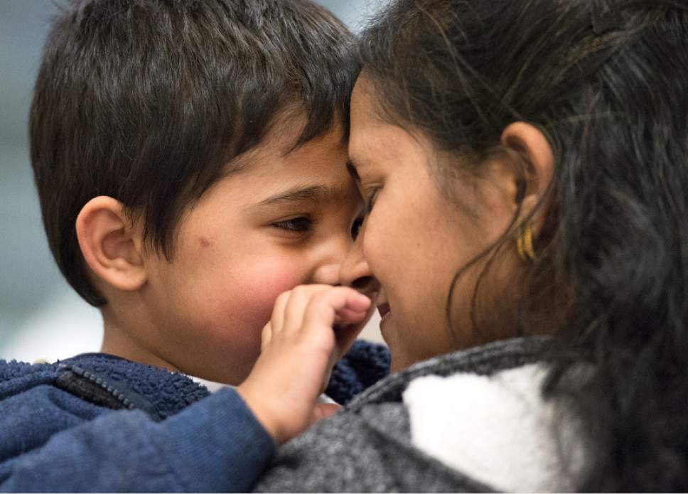 "Leah Hogsten  |  The Salt Lake Tribune Sarita Sah, snuggles with her grandson Keshav, 3. Sarita Sah, who arrived in Utah from India three weeks ago, has been getting to know her grandson for the first time. Sarita and her husband Ken, were forced to leave the U.S. in 2006 after losing their legal battle with Immigration authorities. Their son, Kunal, has been running the family's hotel business in Green River since 2011, trying to keep his parentsí dream alive without them. ""We will earn money again,"" said Sarita. ""We got our son back, this business back,"" said Sarita, ""we are going to work hard again."""