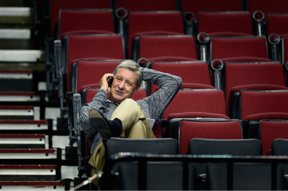 Scott Sommerdorf   |  The Salt Lake Tribune Utah Athletic Director, Dr. Chris Hill speaks on his phone as the Utes practice at the Moda Center in Portland, Wednesday, March 18, 2015.