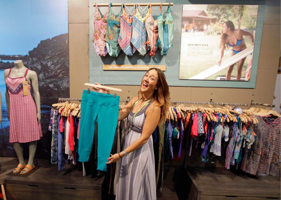 Exhibitor Charlotte Pavik, of Prana, holds Prana yoga pants at their exhibit during the Outdoor Retailer show Thursday, Aug. 4, 2016, in Salt Lake City. A wide array of clothing, gear and equipment specifically designed for women outdoor adventurers is on display at the summer version of the world's largest outdoor gear show for retailers that brings thousands of people to Salt Lake City. (AP Photo/Rick Bowmer)