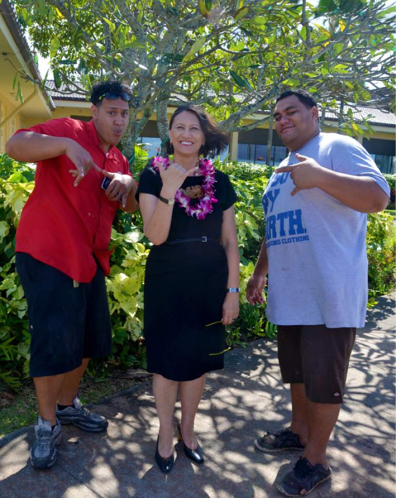 Michael Stack  |  Courtesy  Jaddy Toelupe, left, and Braden Sika, right, with Debbie Hippolite-Wright, BYU-Hawaii vice president, who objects to the commercialization and exploitation of haka, a sacred Maori dance.