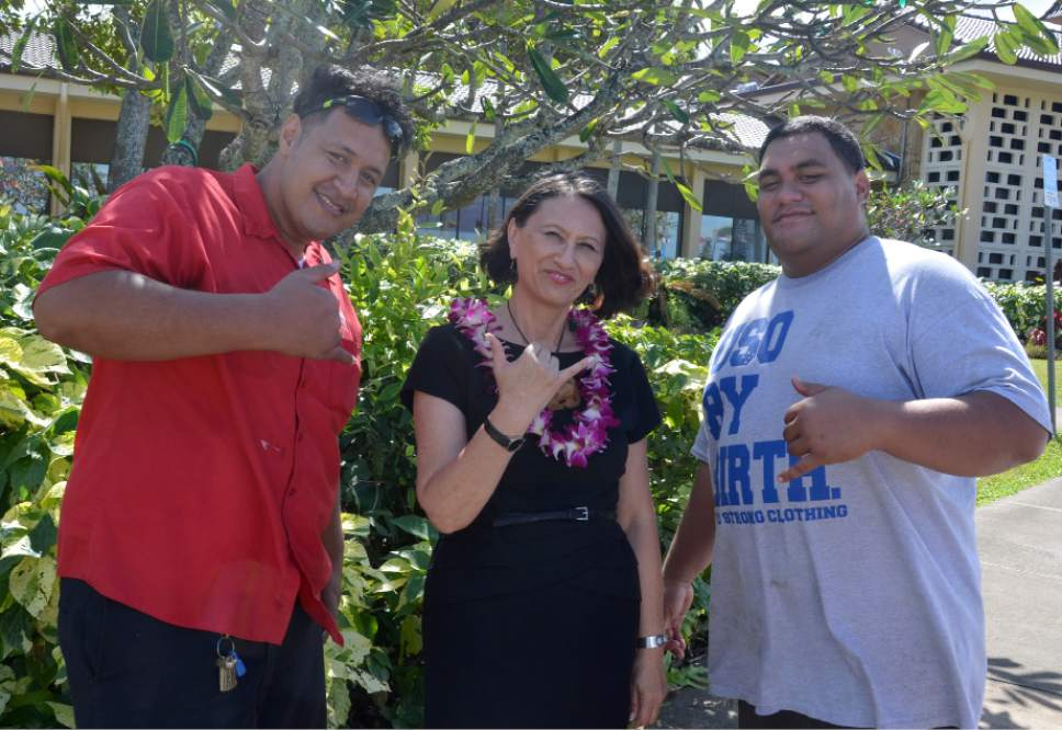Michael Stack     Courtesy  JaddyToelupe, left, and BradenSika, right, with Debbie Hippolite-Wright, BYU-Hawaii vice president, who objects to the commercialization and exploitation of haka, a sacred Maori dance.