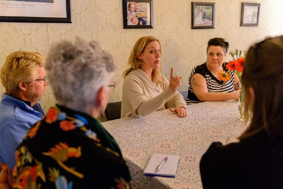 Trent Nelson     Tribune file photo Joanna Smith (center), founder of Utah Women Unite, at a meeting of the group in Salt Lake City, Thursday February 16, 2017.