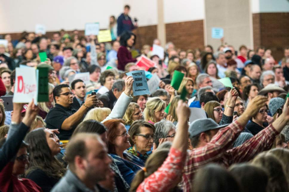 Chris Detrick     The Salt Lake Tribune Members of the audience hold up signs as U.S. Rep. Jason Chaffetz, R-Utah, speaks during the town-hall meeting in Brighton High School Thursday February 9, 2017.