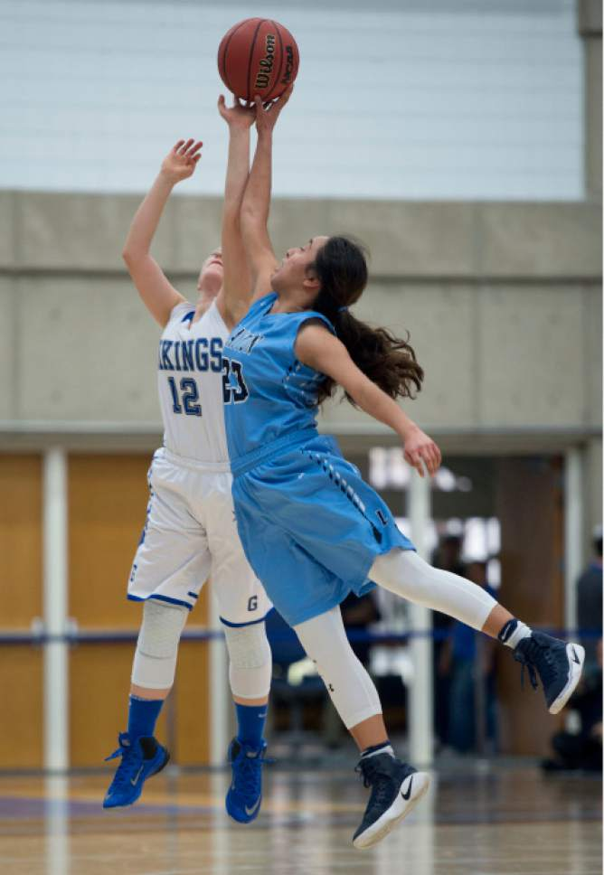 Steve Griffin  |  The Salt Lake Tribune   Pleasant Grove's Alexis Reeves, left and Layton's Brenda Gallegos leap for the ball during the girl's 5A basketball tournament at the SLCC gym in Salt Lake City Monday February 20, 2017