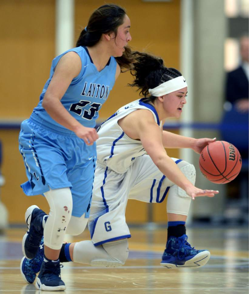 Steve Griffin  |  The Salt Lake Tribune   Pleasant Grove's Malia Brown drives past Layton's Brenda Gallegos during the girl's 5A basketball tournament at the SLCC gym in Salt Lake City Monday February 20, 2017