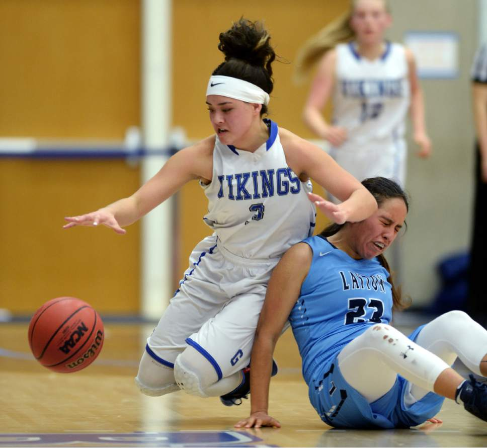 Steve Griffin  |  The Salt Lake Tribune   Pleasant Grove's Malia Brown, left, and Layton's Brenda Gallegos crash to the court during the girl's 5A basketball tournament at the SLCC gym in Salt Lake City Monday February 20, 2017