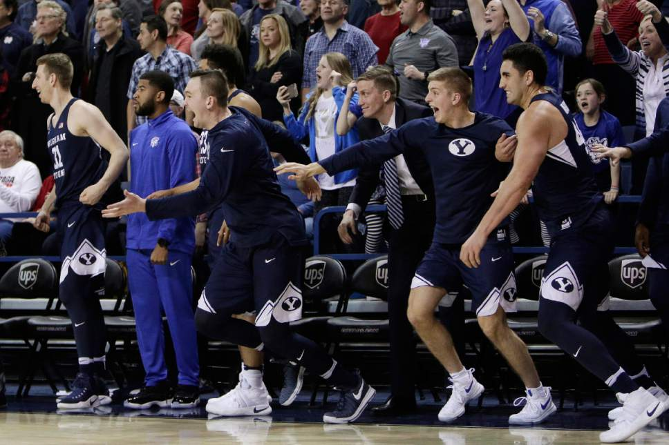 Players on the BYU bench celebrate at the end of the team's NCAA college basketball game against Gonzaga in Spokane, Wash., Saturday, Feb. 25, 2017. BYU defeated No. 1 Gonzaga 79-71. (AP Photo/Young Kwak)