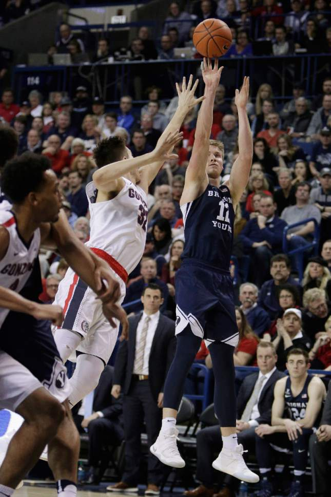 BYU forward Eric Mika (12) shoots against Gonzaga forward Zach Collins (32) during the second half of an NCAA college basketball game in Spokane, Wash., Saturday, Feb. 25, 2017. BYU won 79-71. (AP Photo/Young Kwak)