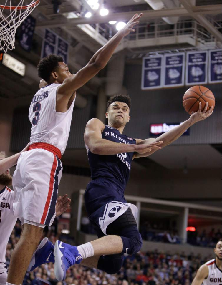 Young Kwak  |  Associated Press file photo BYU guard Elijah Bryant, right, shoots against Gonzaga forward Johnathan Williams during the first half of an NCAA college basketball game in Spokane, Wash., in February.