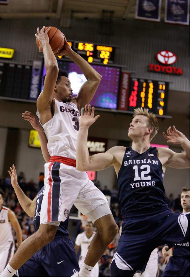 Gonzaga forward Johnathan Williams (3) grabs a rebound next to BYU forward Eric Mika (12) during the first half of an NCAA college basketball game in Spokane, Wash., Saturday, Feb. 25, 2017. (AP Photo/Young Kwak)