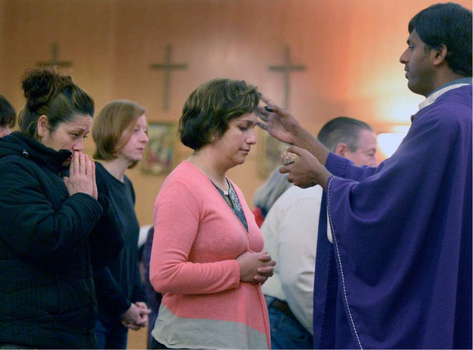 Al Hartmann  |  The Salt Lake Tribune Father Arokia Dass makes the sign of the cross on foreheads of parishioners during service at Saints Peter and Paul Catholic Church in West Valley City on Ash Wednesday, Feb. 10, 2016, marking the start of Lent.