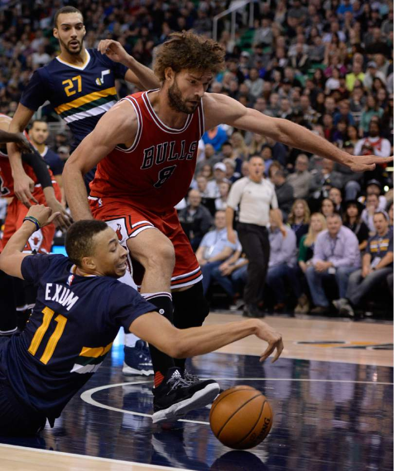 Francisco Kjolseth | The Salt Lake Tribune Utah Jazz guard Dante Exum (11) is unable to regain control of the ball while pressured by Chicago Bulls center Robin Lopez (8) in NBA action, in Salt Lake City, Thursday, November 17, 2016.