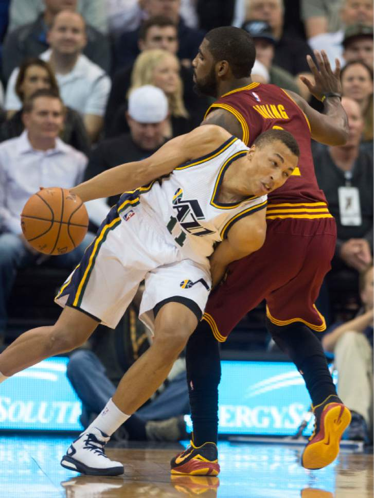 Steve Griffin  |  The Salt Lake Tribune   Utah Jazz guard Dante Exum (11) dips his shoulder as he drives around Cleveland Cavaliers guard Kyrie Irving (2) during first half action in the Jazz versus Cavs NBA game at EnergySolutions Arena in Salt Lake City, Wednesday, November 5, 2014.