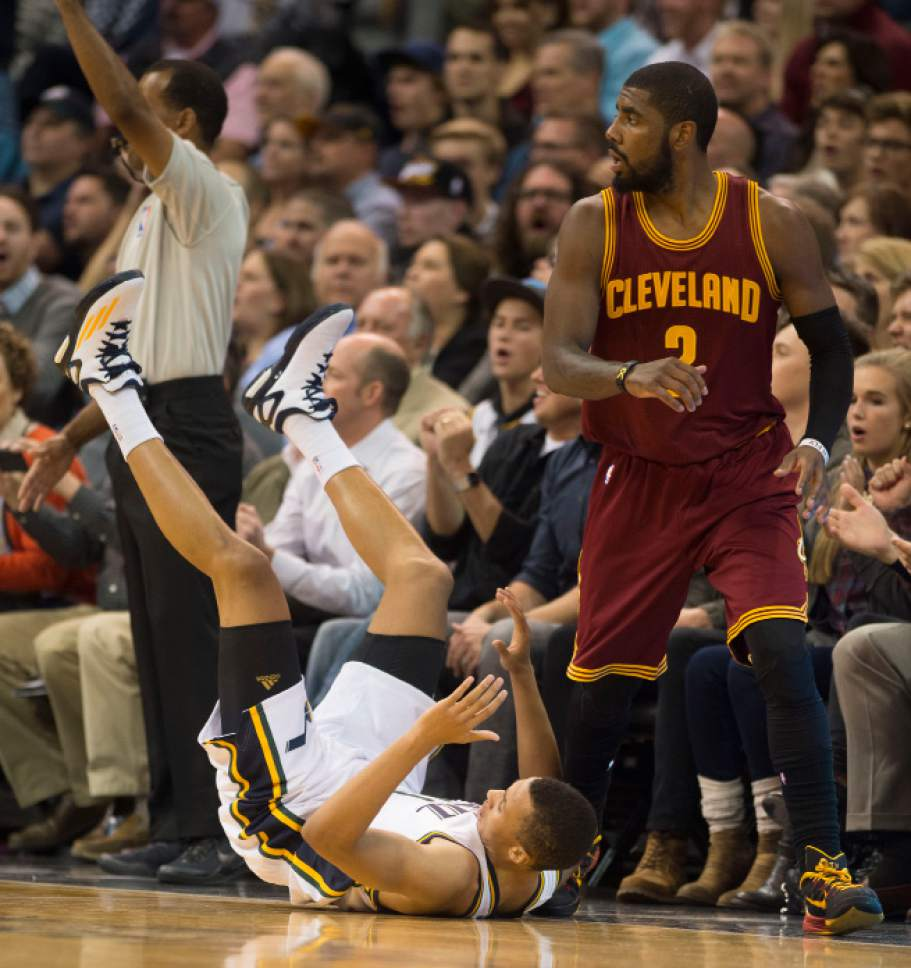 Steve Griffin  |  The Salt Lake Tribune   Utah Jazz guard Dante Exum (11)false to the ground after trying to shoot over Cleveland Cavaliers guard Kyrie Irving (2) during first half action in the Jazz versus Cavs NBA game at EnergySolutions Arena in Salt Lake City, Wednesday, November 5, 2014.