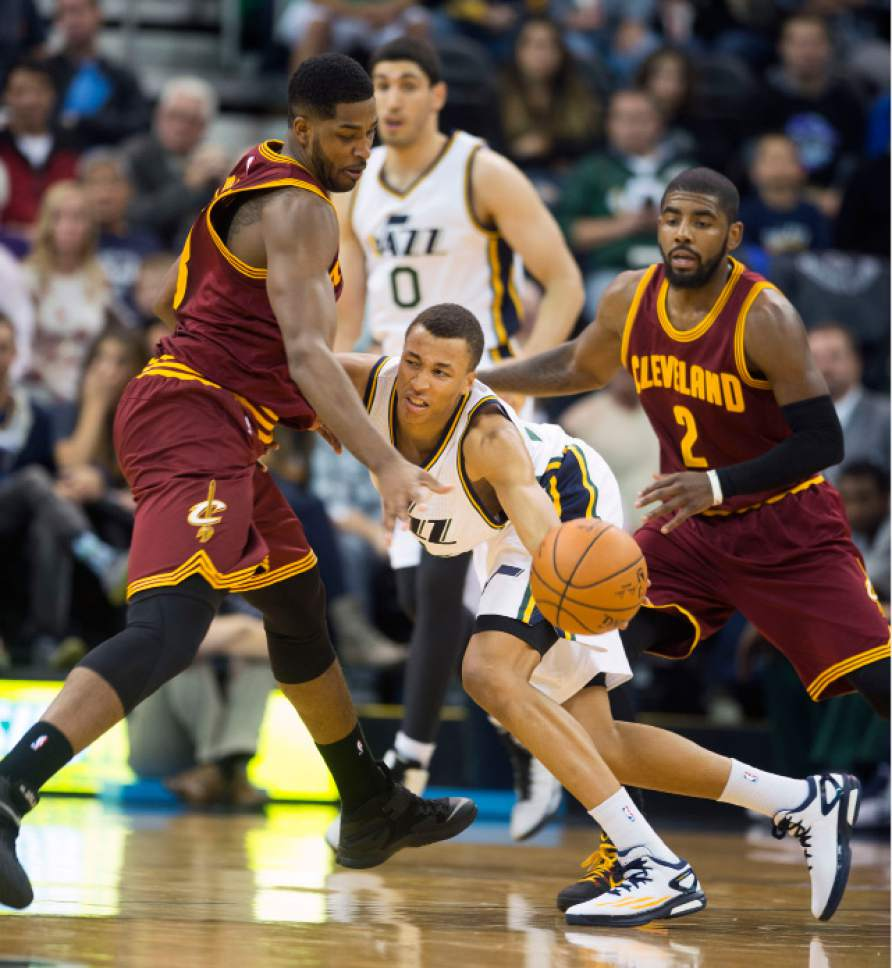 Steve Griffin  |  The Salt Lake Tribune   Utah Jazz guard Dante Exum (11) get trapped by Cleveland Cavaliers forward Tristan Thompson (13) and Cleveland Cavaliers guard Kyrie Irving (2) during first half action in the Jazz versus Cavs NBA game at EnergySolutions Arena in Salt Lake City, Wednesday, November 5, 2014.
