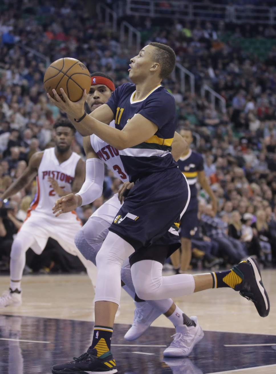 Utah Jazz guard Dante Exum (11)goes to the basket as Detroit Pistons forward Tobias Harris, rear, defends in the second half during an NBA basketball game Friday, Jan. 13, 2017, in Salt Lake City. The Jazz won 110-77. (AP Photo/Rick Bowmer)