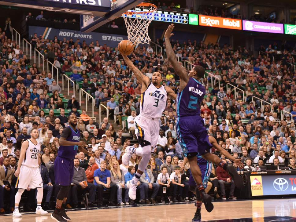 Lennie Mahler  |  The Salt Lake Tribune  George Hill goes up hard and is fouled by Charlotte's Marvin Williams in a game at Vivint Smart Home Arena on Saturday, Feb. 4, 2017.