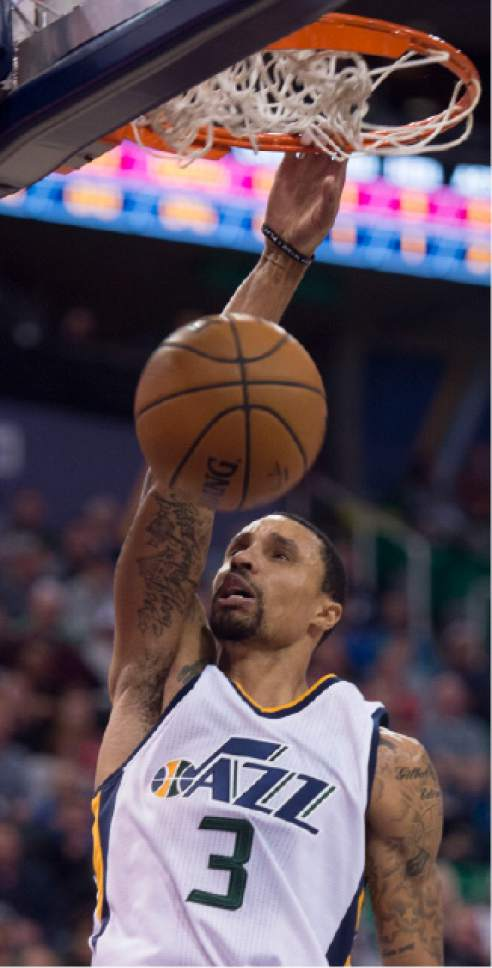 Steve Griffin / The Salt Lake Tribune  Utah Jazz guard George Hill (3) dunks the ball during the Utah Jazz versus Cleveland Cavaliers NBA basketball game at Vivint Smart Home Arena in Salt Lake City Tuesday January 10, 2017.