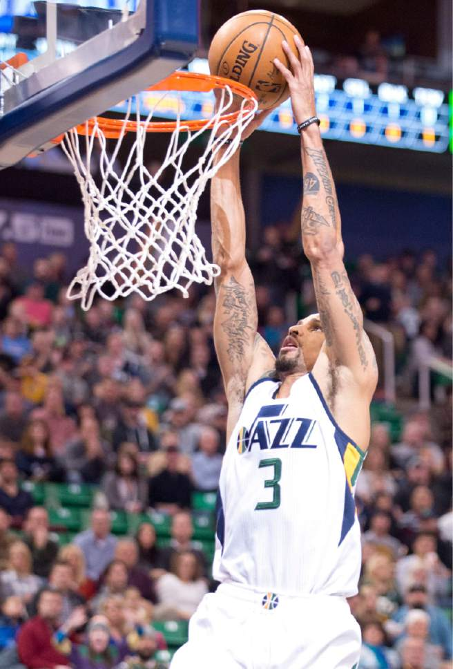 Lennie Mahler  |  The Salt Lake Tribune  George Hill dunks the ball in a game against the Memphis Grizzlies on Saturday, Jan. 28, 2017, at Vivint Smart Home Arena in Salt Lake City.