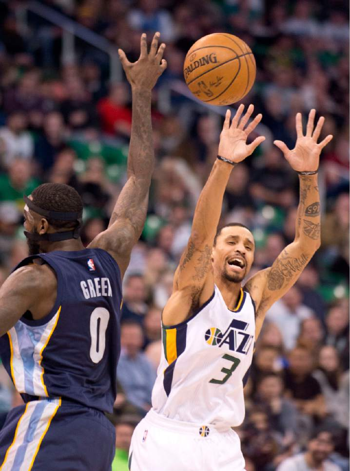 Lennie Mahler  |  The Salt Lake Tribune  George Hill loses control of the ball to JaMychal Green in a game against the Memphis Grizzlies on Saturday, Jan. 28, 2017, at Vivint Smart Home Arena in Salt Lake City.