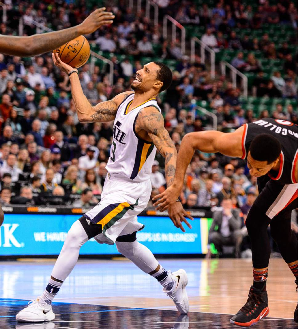 Trent Nelson  |  The Salt Lake Tribune Utah Jazz guard George Hill (3) goes to the basket, tangled up with Portland Trail Blazers guard C.J. McCollum (3) as the Utah Jazz host the Portland Trailblazers, NBA basketball in Salt Lake City, Wednesday February 15, 2017.