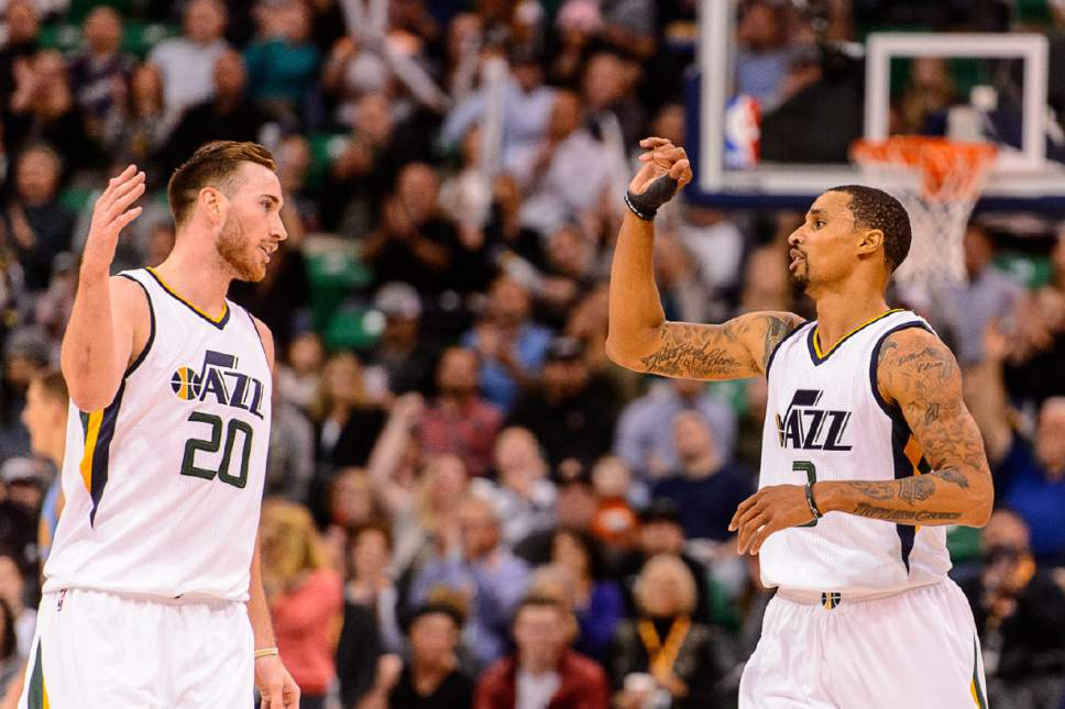 Trent Nelson  |  The Salt Lake Tribune Utah Jazz forward Gordon Hayward (20) and Utah Jazz guard George Hill (3) high-five as the Utah Jazz host the Denver Nuggets in Salt Lake City, Wednesday November 23, 2016.