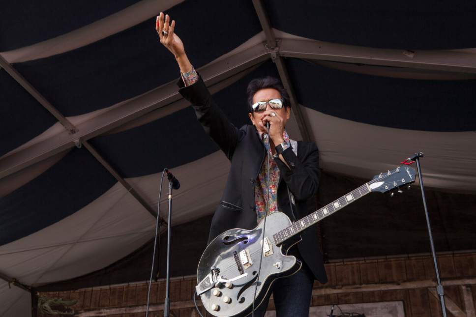 Singer/guitarist Alejandro Escovedo & The Sensitive Boys perform at the New Orleans Jazz and Heritage Festival in New Orleans on Friday, May 2, 2014. (Photo by Barry Brecheisen/Invision/AP)