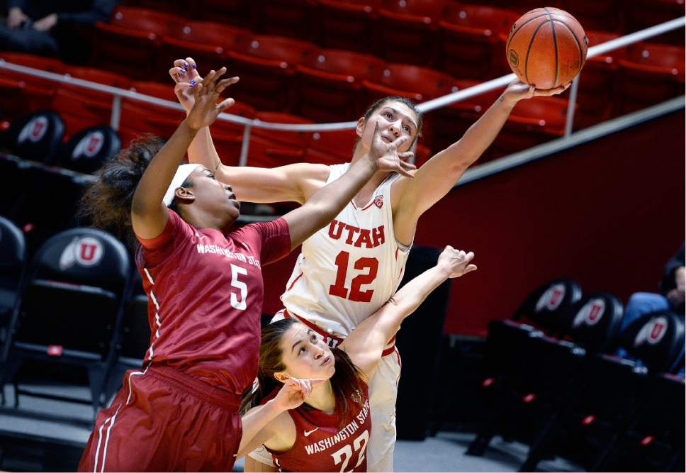 Scott Sommerdorf   |  The Salt Lake Tribune   Utah Utes forward Emily Potter (12) reaches for a rebound while sandwiched between Washington State Cougars forward Kayla Washington (5) and Washington State Cougars guard Pinelopi Pavlopoulou (22) during first half play. Washington State led Utah 27-22 at the half, Sunday, February 5, 2017.