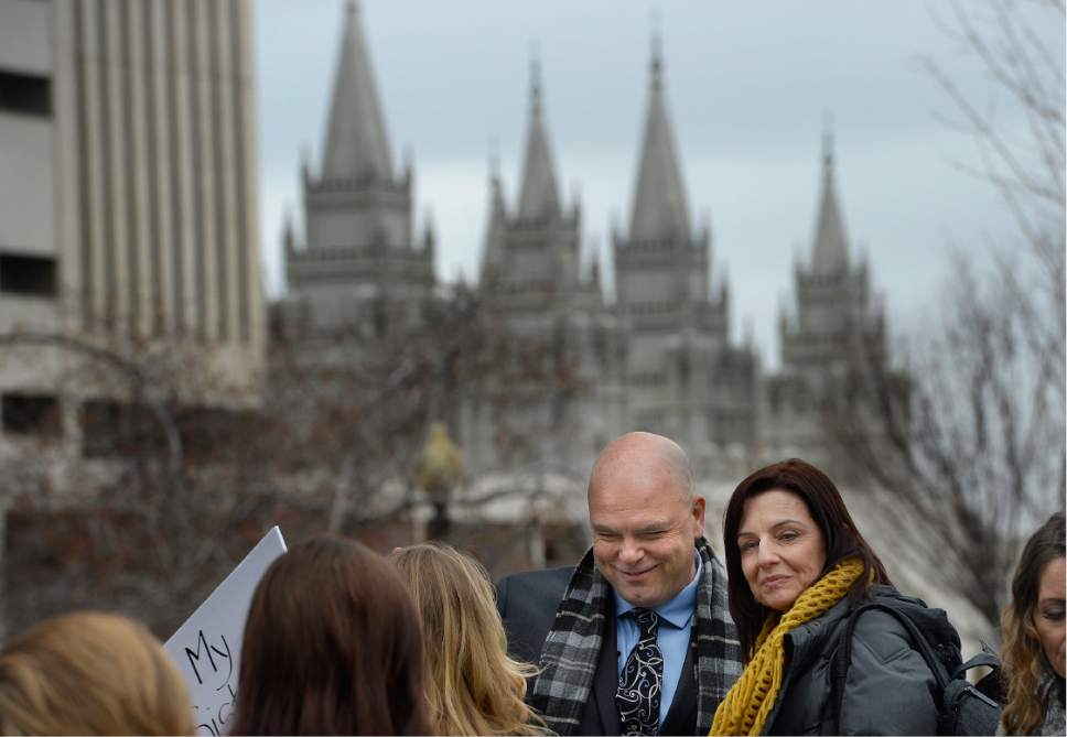 Scott Sommerdorf   |  The Salt Lake Tribune   Joe Darger greeted others in City Creek Park prior joining with polygamists and their supporters and marching to the Capitol where they held a rally, Friday, February 10, 2017.