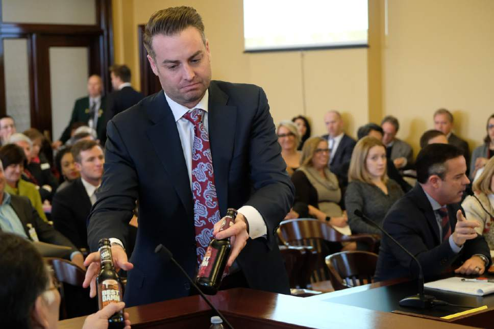 Francisco Kjolseth | The Salt Lake Tribune Lincoln Shurtz with the Salt Lake Area Restaurant Association hands members of the House Business and Labor Standing Committee flavored beer bottles that have colorful labels similar to soda pop. Wednesday, March 1, 2017.