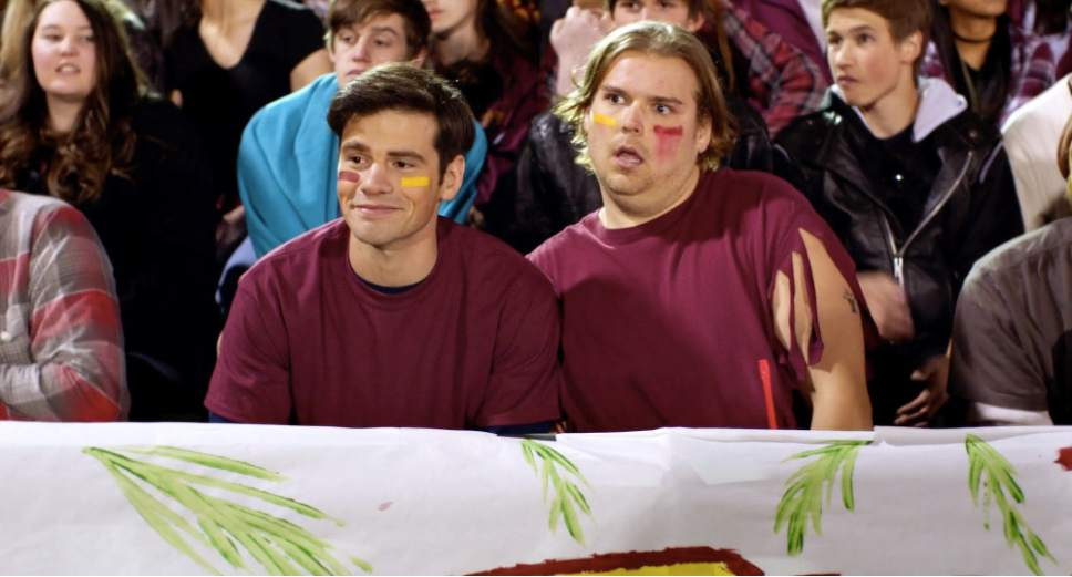"Student body president Tim Timmerman (Eddie Perino, left) attends a football game with his stoner pal Garrett (Andrew Caldwell) in the teen comedy ""Tim Timmerman: Hero of America."" Courtesy VidAngel Studios / Picture Picture Films"
