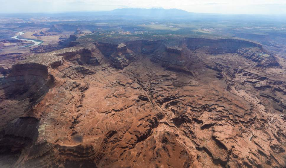 Francisco Kjolseth | The Salt Lake Tribune Lockhart Basin, seen south of the Colorado River, falls within the boundary of the proposed Bears Ears region in southeastern Utah, which is subject to a possible National Monument designation by President Obama under the Antiquities Act for protection. EcoFlight recently flew journalists, tribal people and activists over the northern portion of the proposed 1.9 million acre site in an effort to push for permanent protection from impacts caused by resource extraction and high-impact public use.