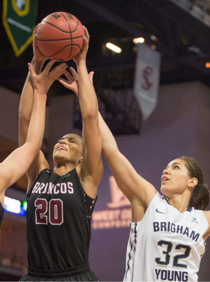 Rick Egan  |  The Salt Lake Tribune  Brigham Young forward Kalani Purcell (32) goes for a rebound along with Santa Clara Broncos forward Lori Parkinson (20), in basketball action in the West Coast Conference Semifinals, at the Orleans Arena in Las Vegas, Saturday, March 7, 2016.