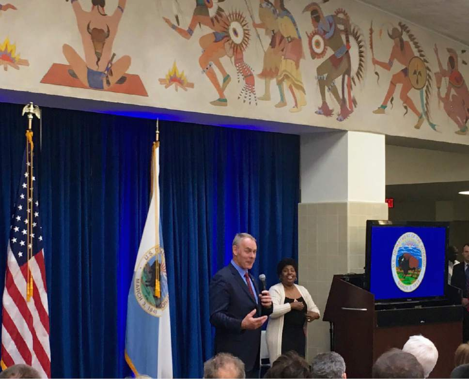 Newly sworn-in Interior Secretary Ryan Zinke speaks to Interior Department employees on the Interior Department's 168th birthday, Friday, March 3, 2017, at the Interior Department in Washington. (AP Photo/Matthew Daly)