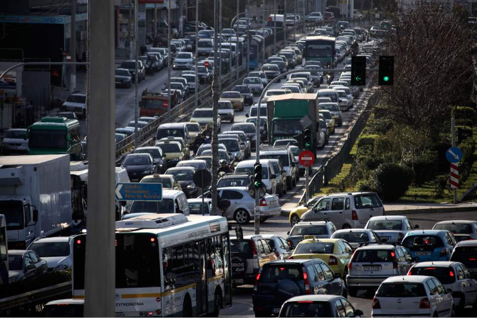 Drivers with their vehicles caught in a traffic jam during a 24-hour strike by metro, urban rail and tram workers in Athens, Friday, March 3, 2107. It's the third strike the last two weeks, against new legislation that will allow the Athens Public Transport Organization (OASA) to make commercial use of stations and areas belonging to STASY, the operator of the capital's fixed-track public transport system. (AP Photo/Yorgos Karahalis)