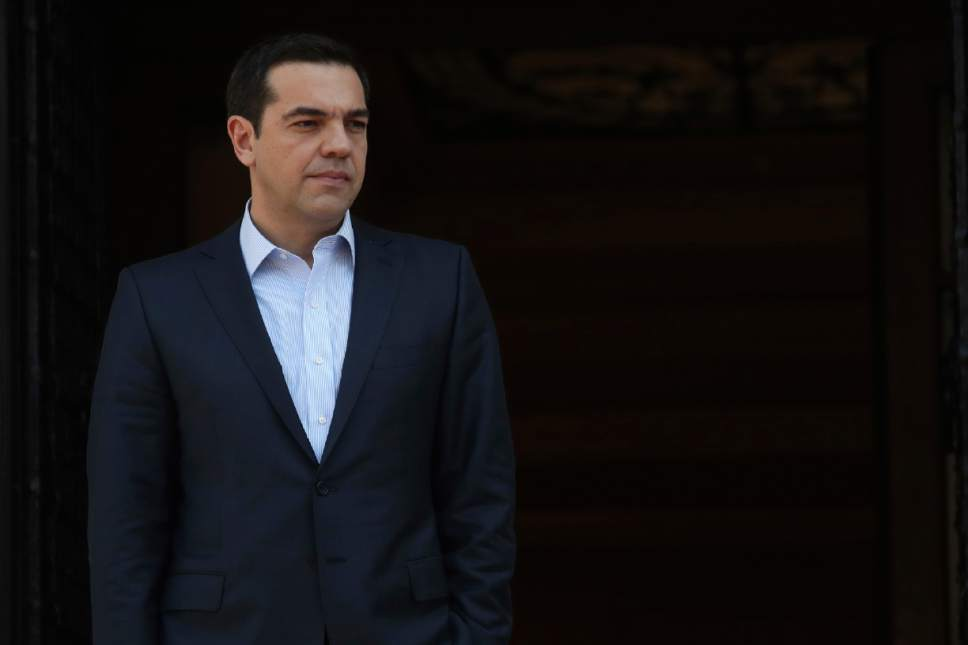 Greece's Prime Minister Alexis Tsipras waits for the arrival of his French counterpart Bernard Cazeneuve at Maximos Mansion in Athens, Friday, March 3, 2017. Cazeneuve and Finance Minister Michel Sapin are in Athens for talks as Greek officials were expected to ask for assistance in overcoming sticking points in the bailout talks. (AP Photo/Yorgos Karahalis)