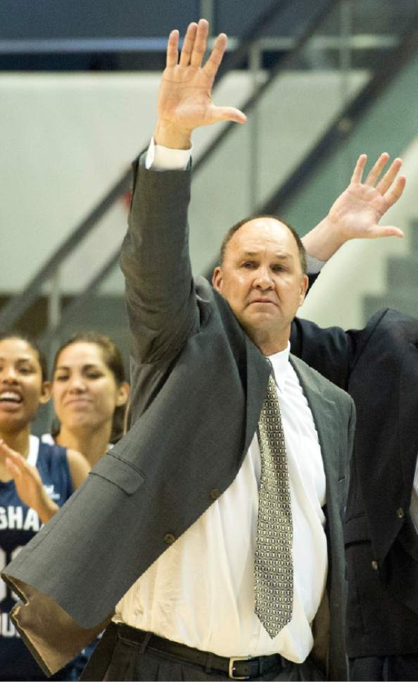 Rick Egan  |  The Salt Lake Tribune  Brigham Young Cougars head coach Jeff Judkins signals to his team, as they lead the Utes in the final minutes of the game, in basketball action, BYU vs. Utah, in the Marriott Center, Saturday, December 12, 2015.