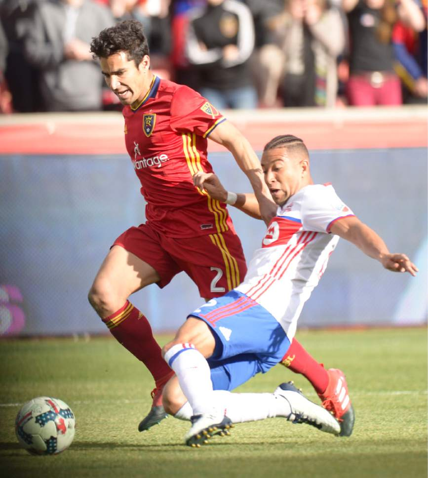 Leah Hogsten  |  The Salt Lake Tribune Real Salt Lake defender Tony Beltran (2) and Toronto FC defender Justin Morrow (2) fight to get to the ball. Real Salt Lake tied the 2017 season home opener with Toronto FC, 0-0, Saturday, March 4, 2017 at Rio Tinto Stadium.