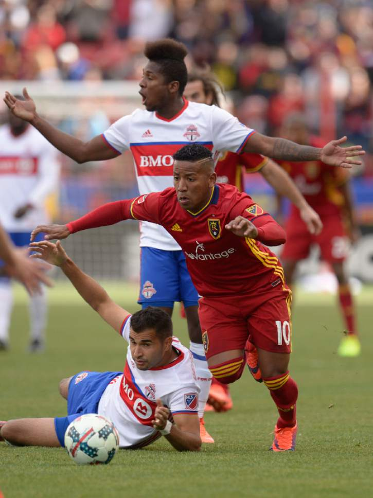 Leah Hogsten  |  The Salt Lake Tribune Possession is overturned on a play between Real Salt Lake forward Joao Plata (10) and Toronto FC defender Steven Beitashour (33). Real Salt Lake tied the 2017 season home opener with Toronto FC, 0-0, Saturday, March 4, 2017 at Rio Tinto Stadium.